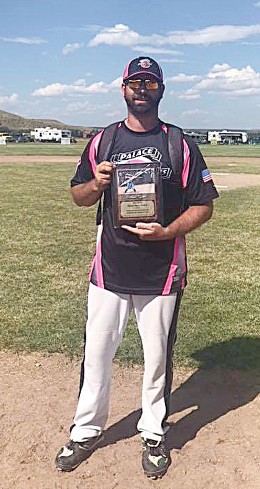 Photo courtesy of George BergRobert Herring, from Skoden, received the Forest Dana award at this year's annual softball tournament. Chosen by tournament coordinators, the recipient of the award best exemplifies the memory of Dana through sportsmanship and hard work.