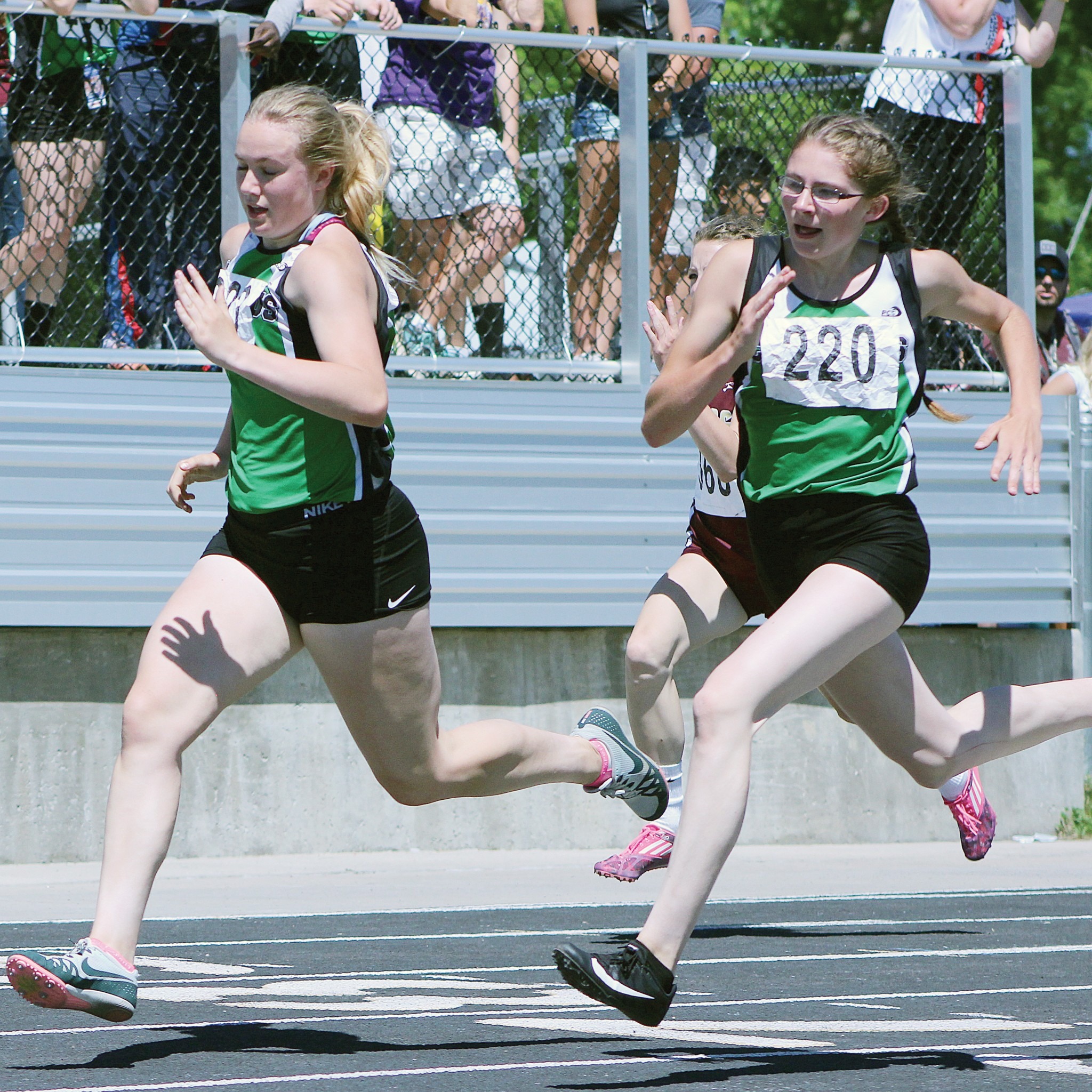 Columbus Cougars RaiLeigh Strommen (left) and Amber LeBrun (right) -- 200m