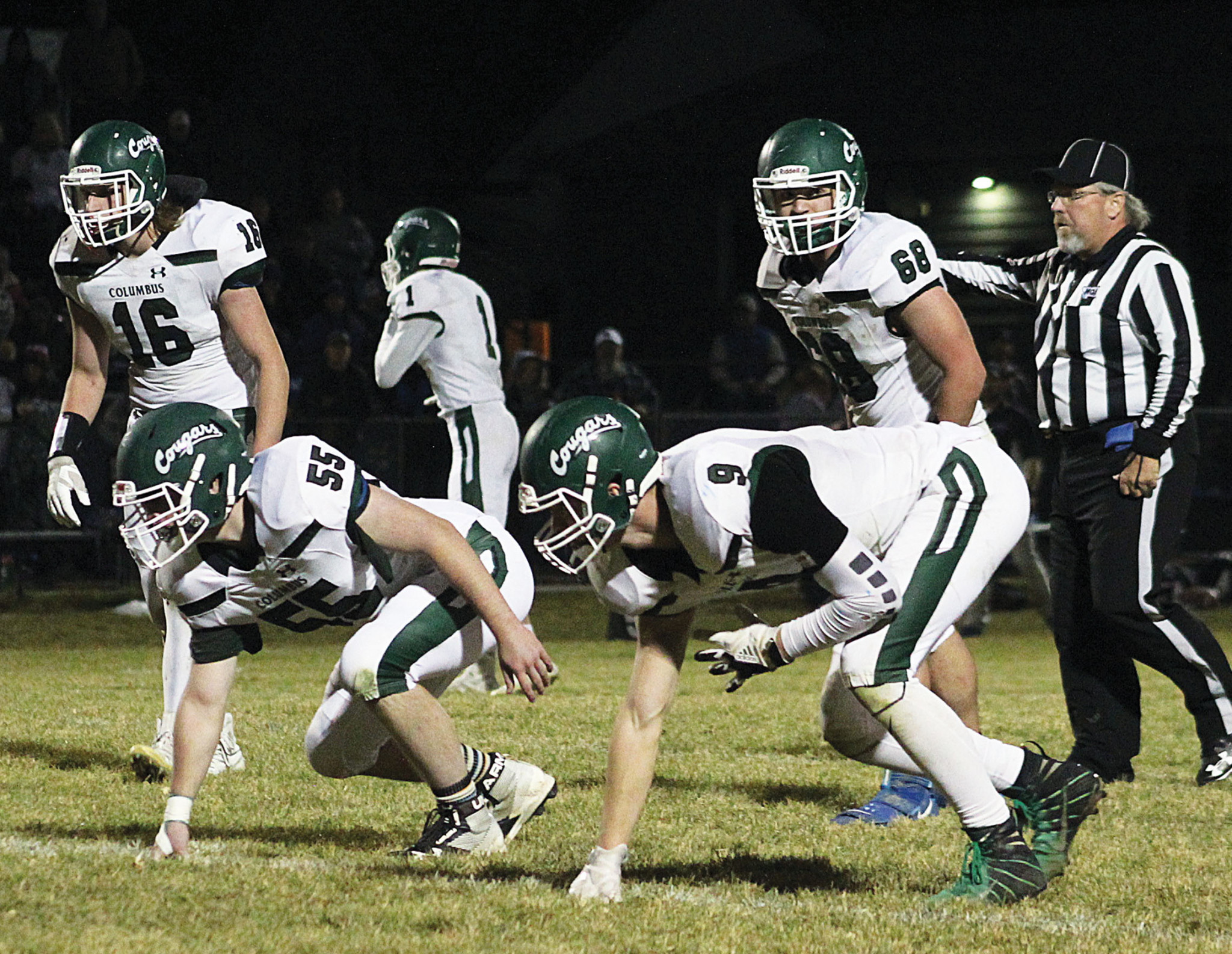 Photo by Lorie Martinez    From the left: Cougar players Keegan Goddard (No. 16), Peyton Alwardt (No. 55), Trey Stampfel (No. 1), Tommy Campbell (No. 9) and Izaak Huncovsky (No. 68).